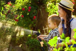 mom and son watering the garden