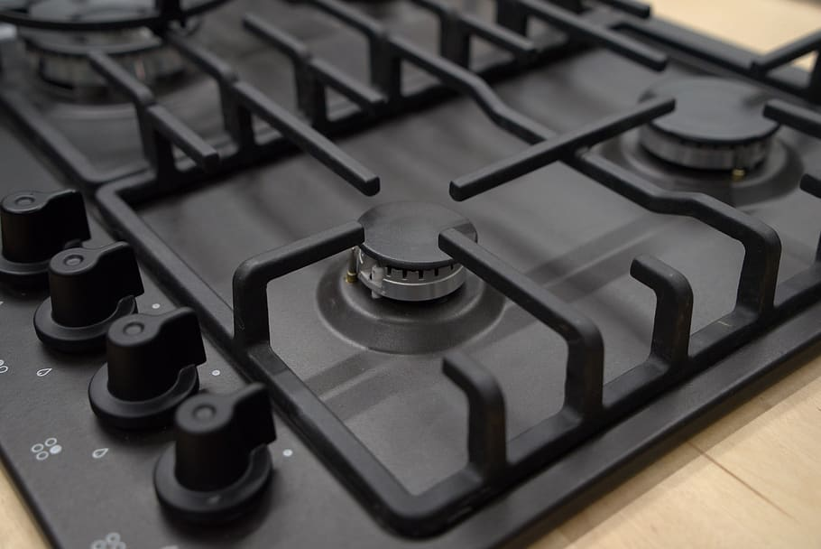 This is a picture of a gas stove top that is not lit or turned on