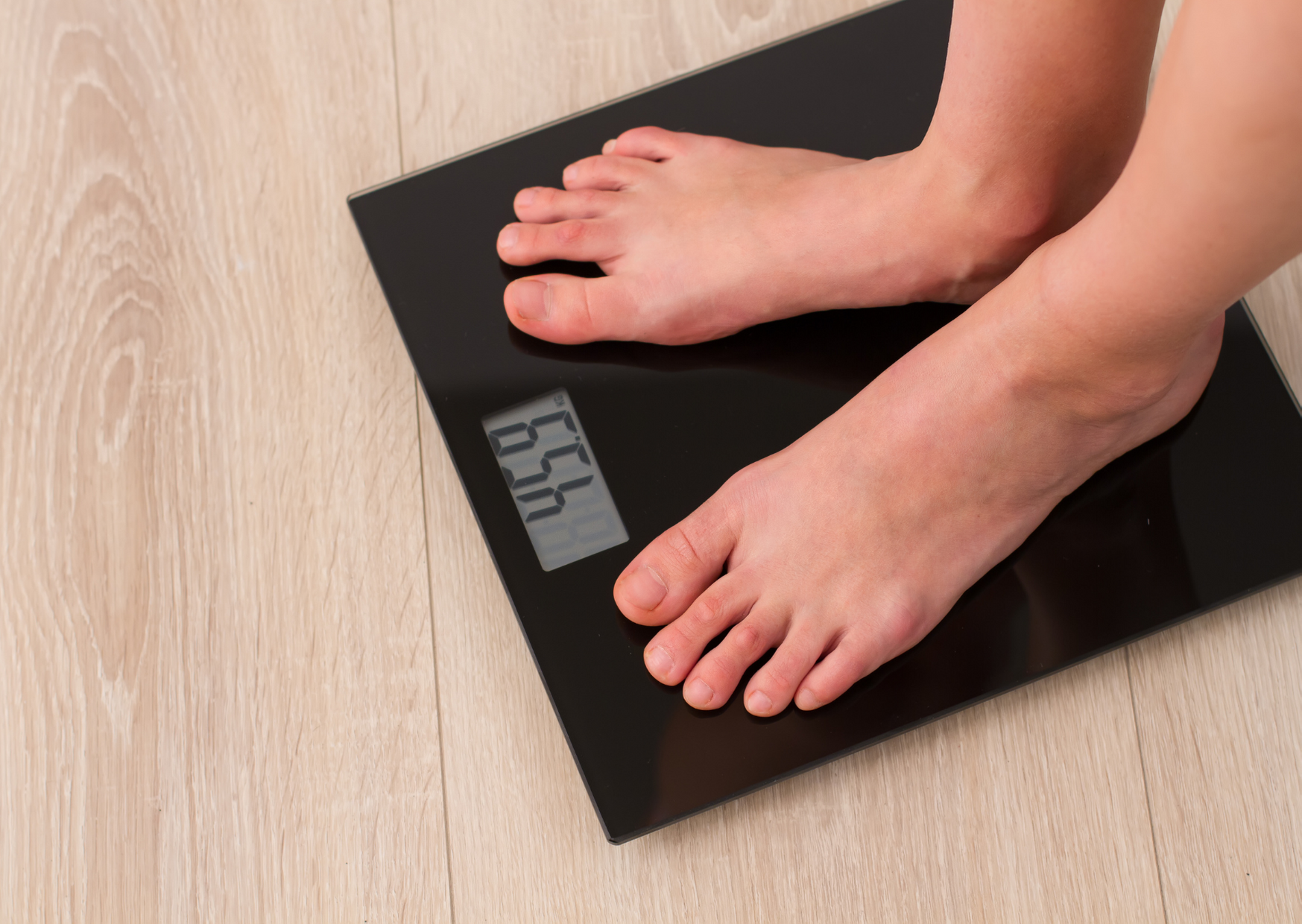 photo of a someone using the smart home scale