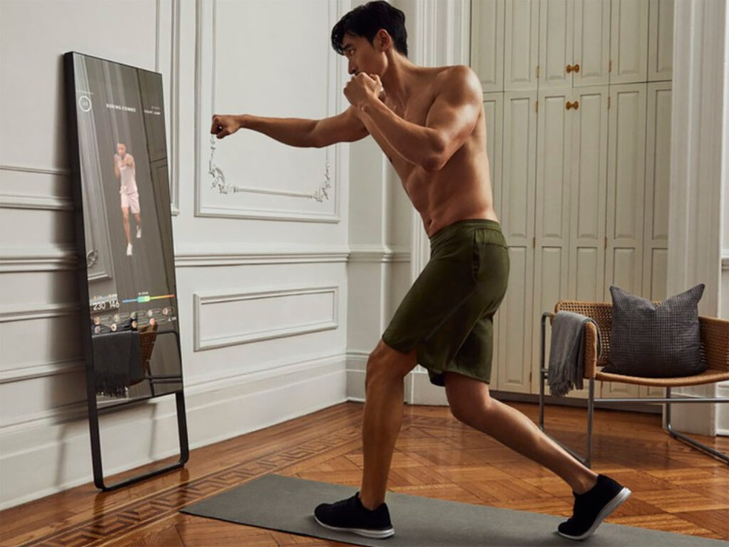 man using smart gym at home