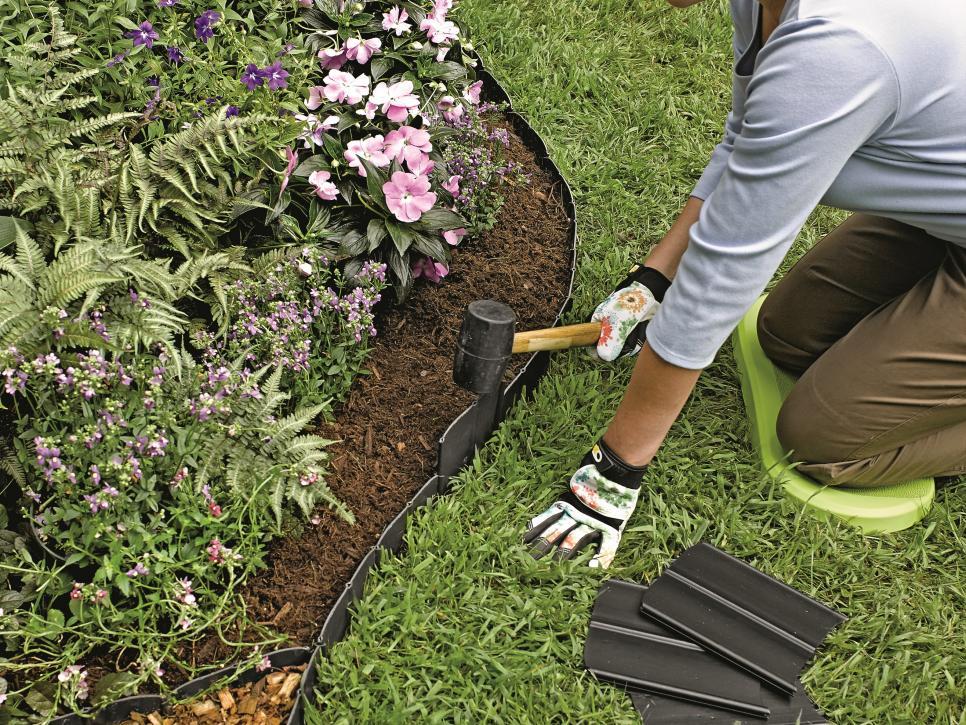 Photo of man installing garden edging
