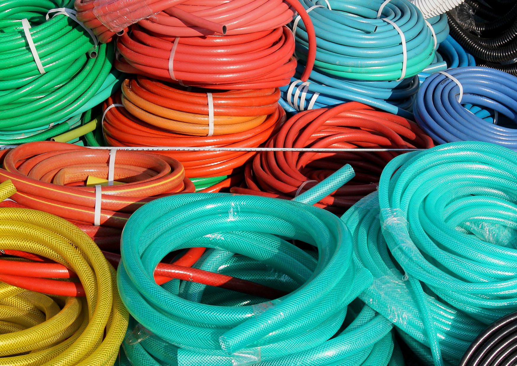 photo of different color of hoses of Are Garden Hoses Recyclable?