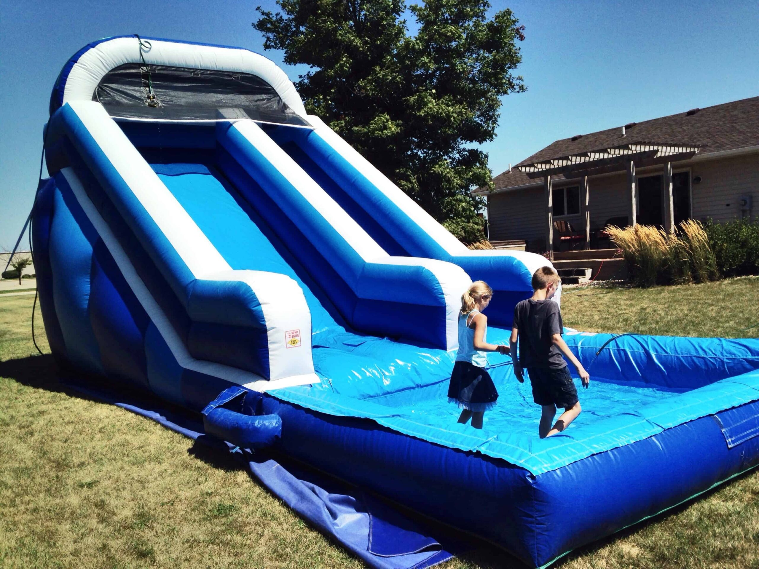 Photo of inflatable water slide with kids playing