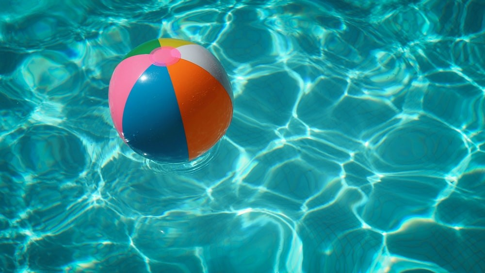 A beach ball floating in water of Summer 2021: 6 Products That Will Solve Your Hot Weather Problems