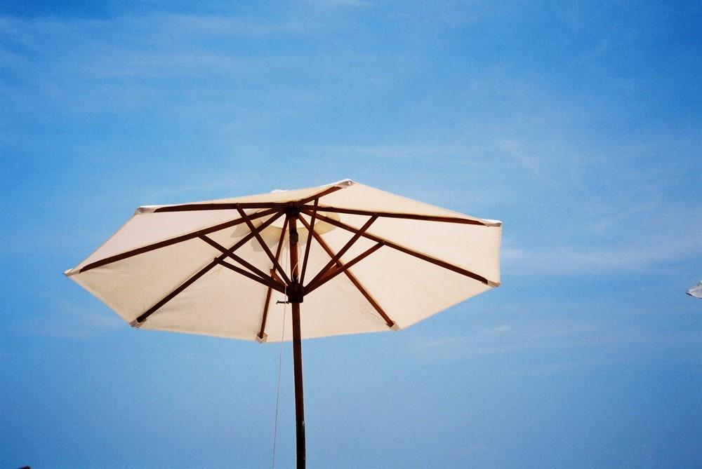 A white patio umbrella