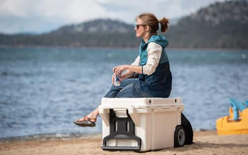 Photo of coolers with wheels have a women sitting