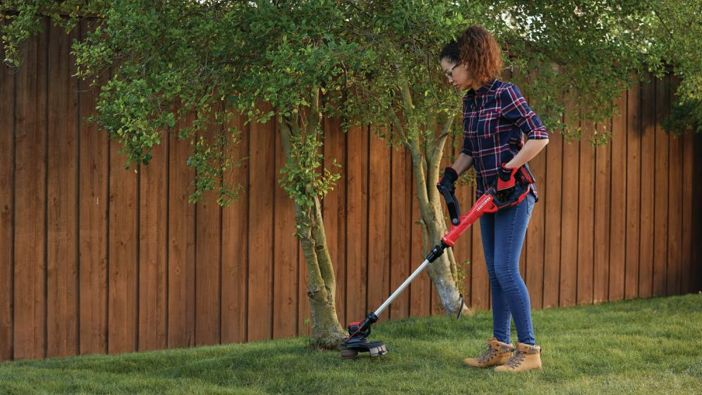 Photo of women while using lawn trimmer and edger