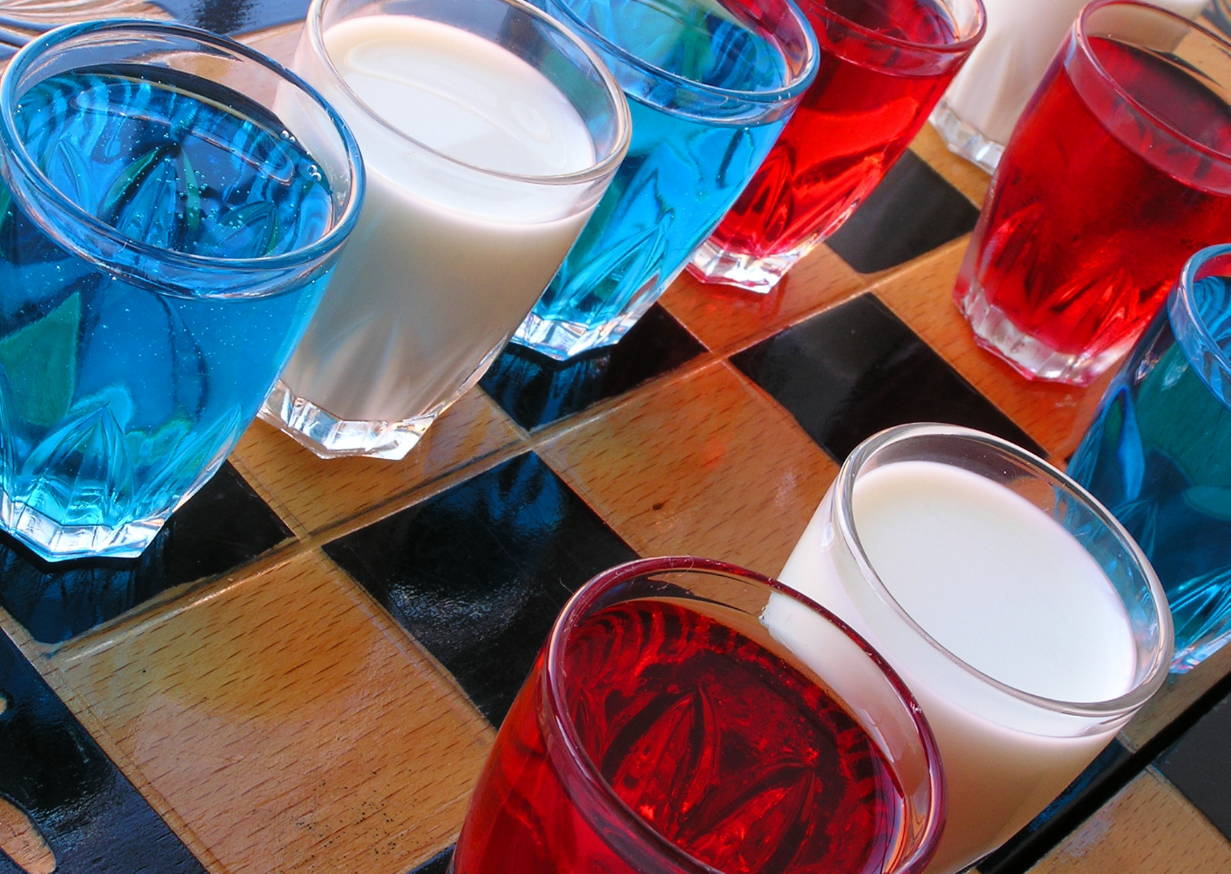 different kind of drink in shot glass of The Best Lawn Drinking Games for Adult Fun