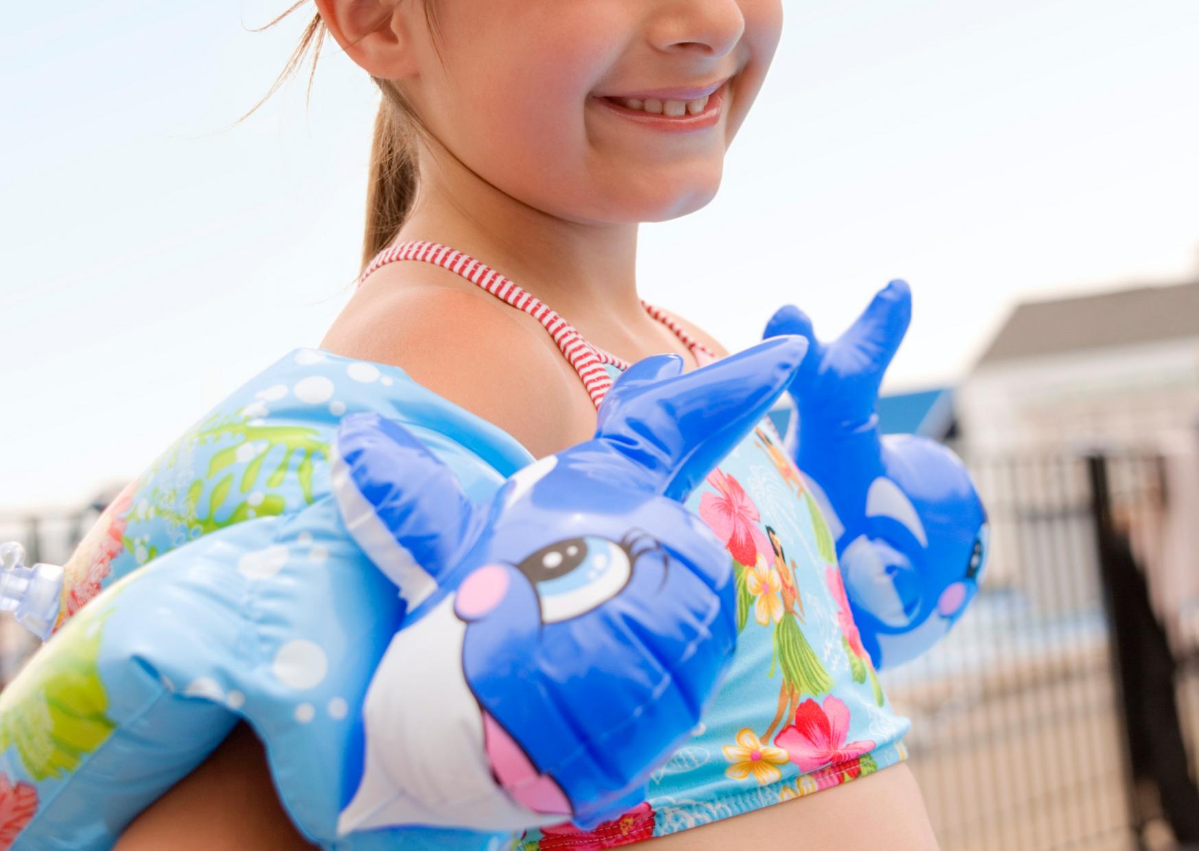 little girl wearing a floaties