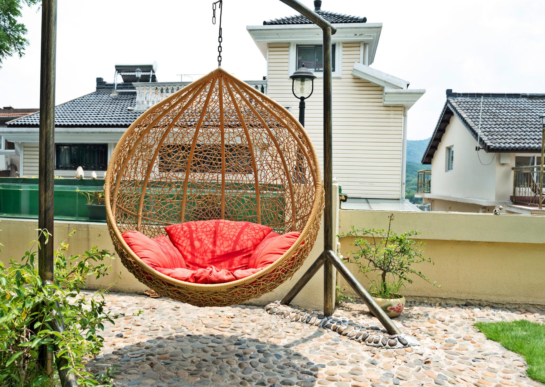 a ratan hanging chair displayed outdoor