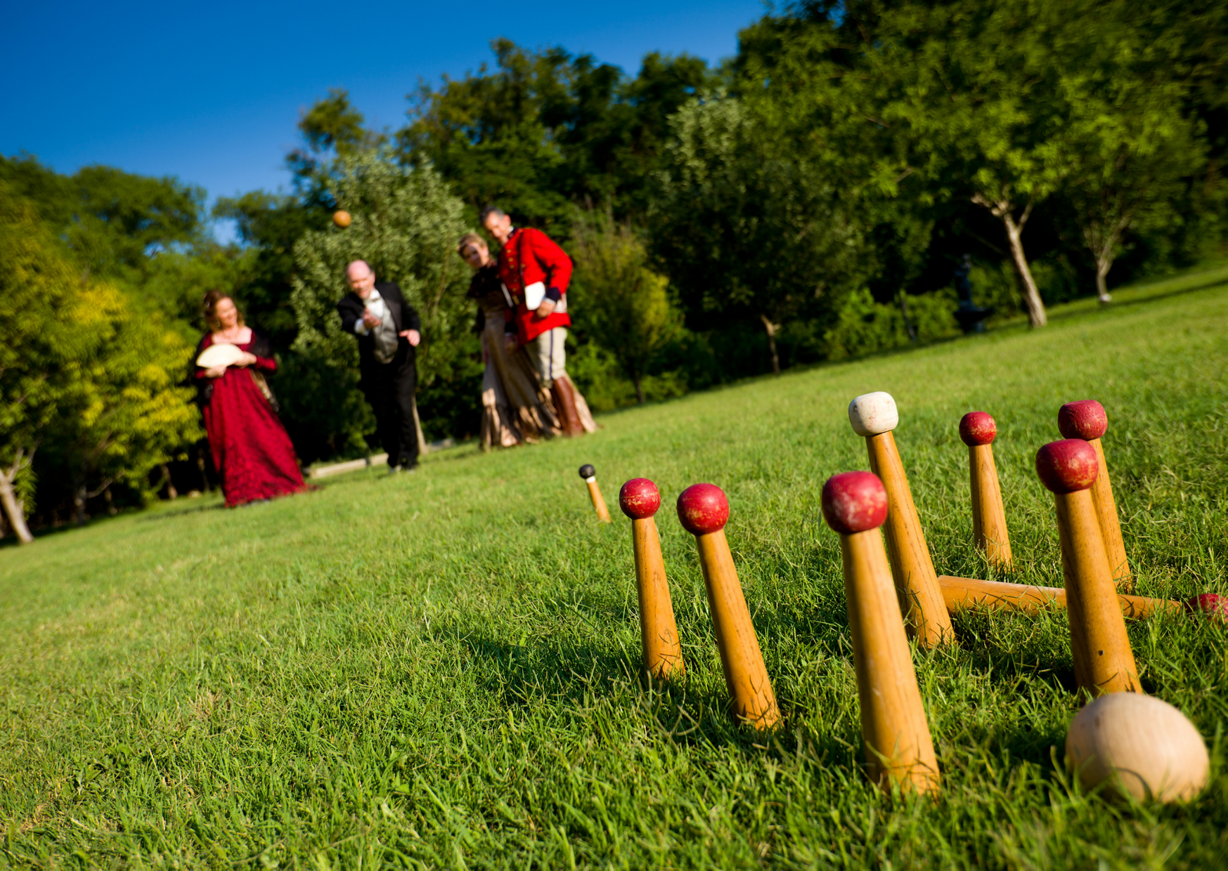 a group of people traditional lawn bowl in Types of Lawn Bowls Games