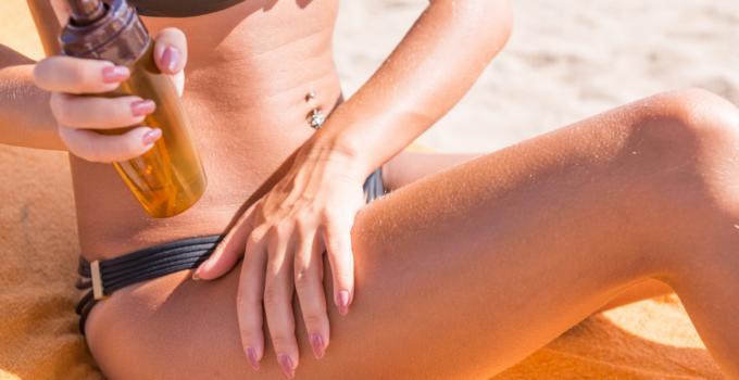 woman putting sun oil