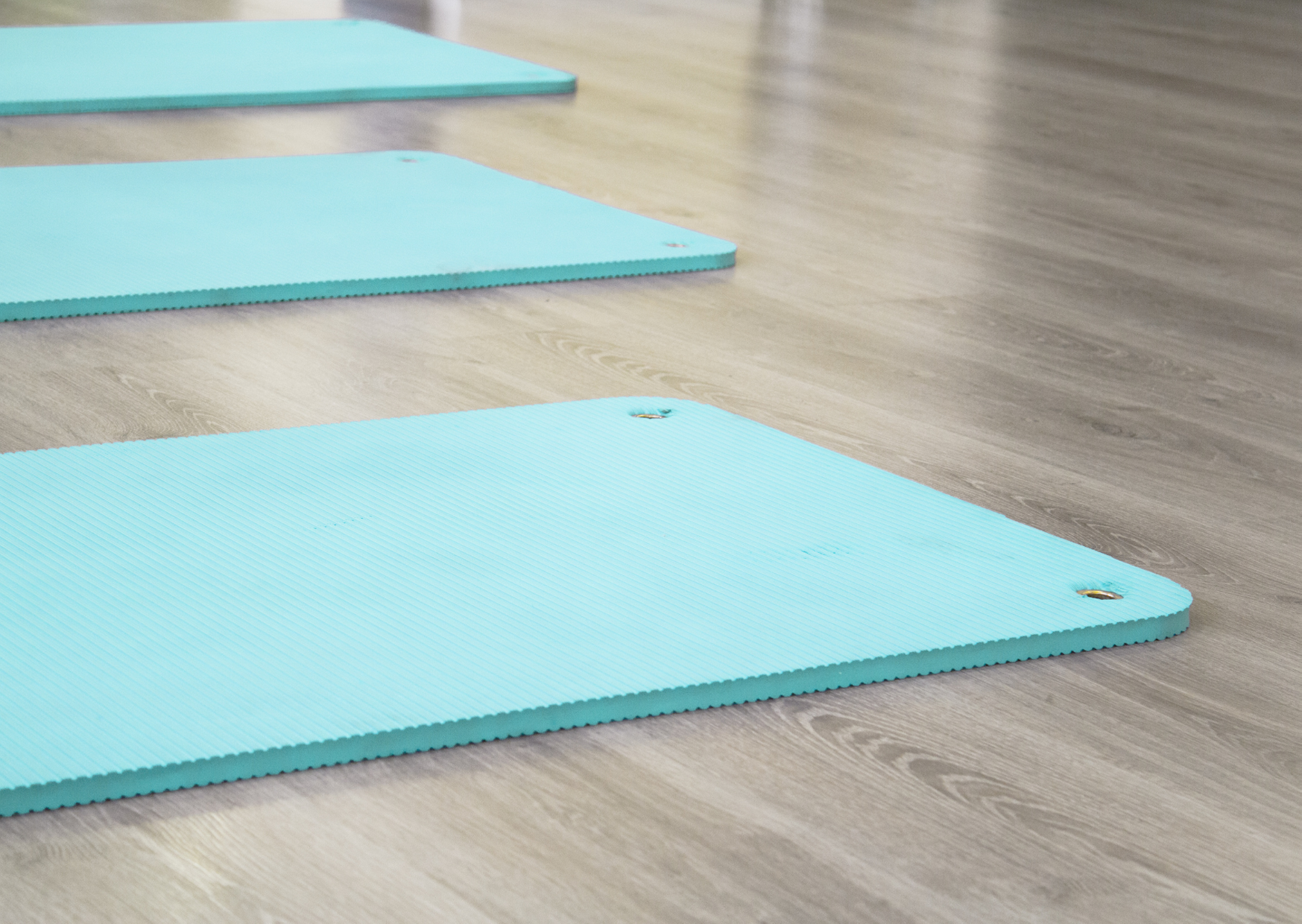 a color mint green thick yoga mat on the floor