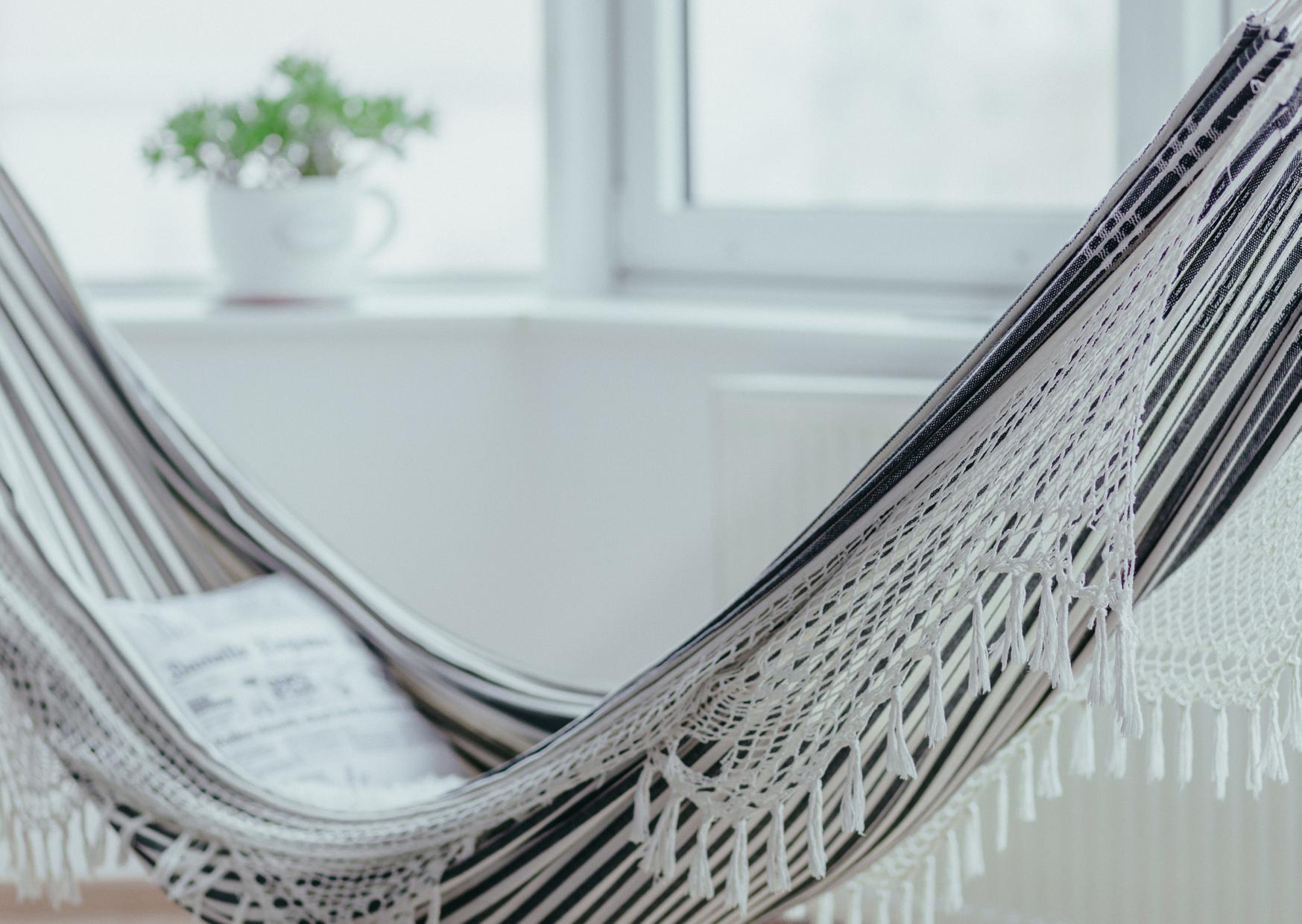 a gray hammock inside the house
