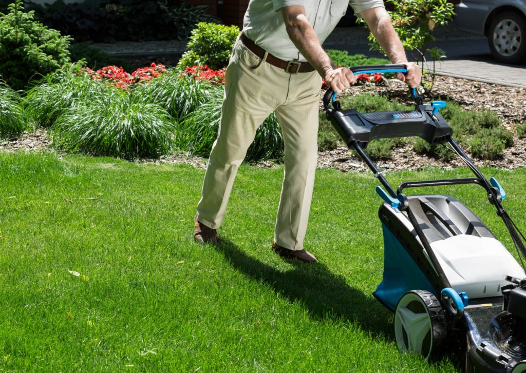 man using a walk behind lawn edger