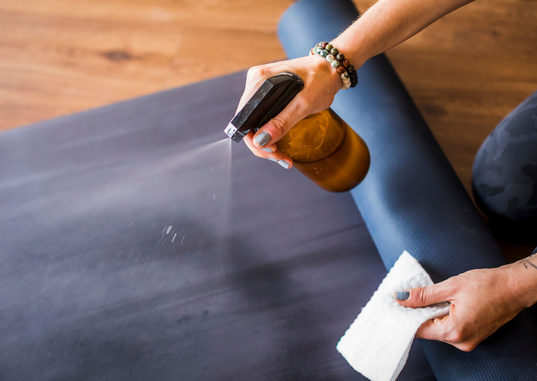 disinfecting a yoga mat with alcohol