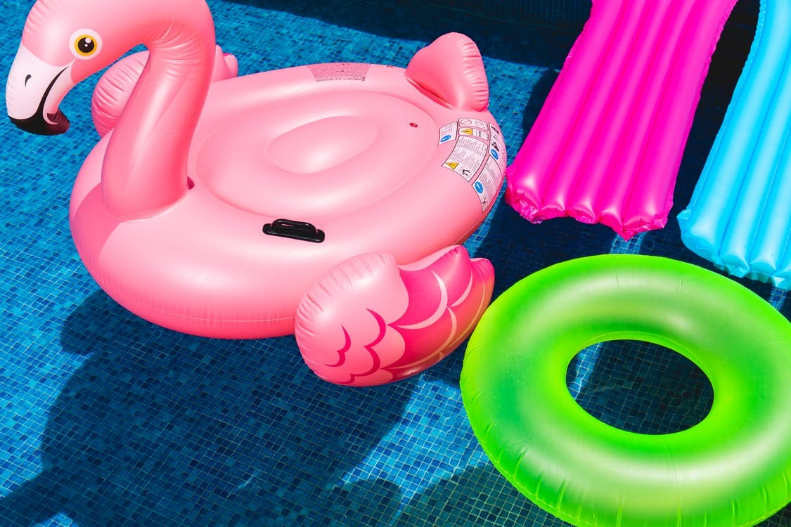 Colorful pool floats and loungers