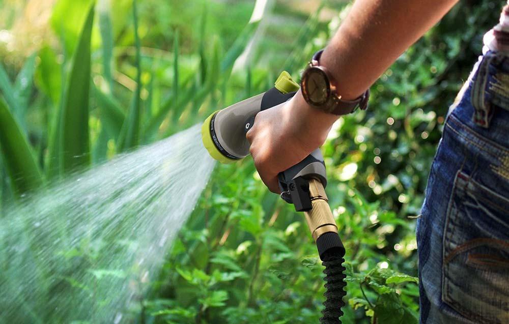 Man using expandable hose