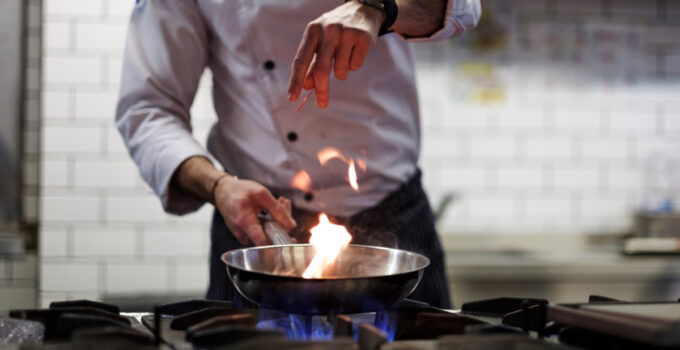 Chef Cooks using gas stove
