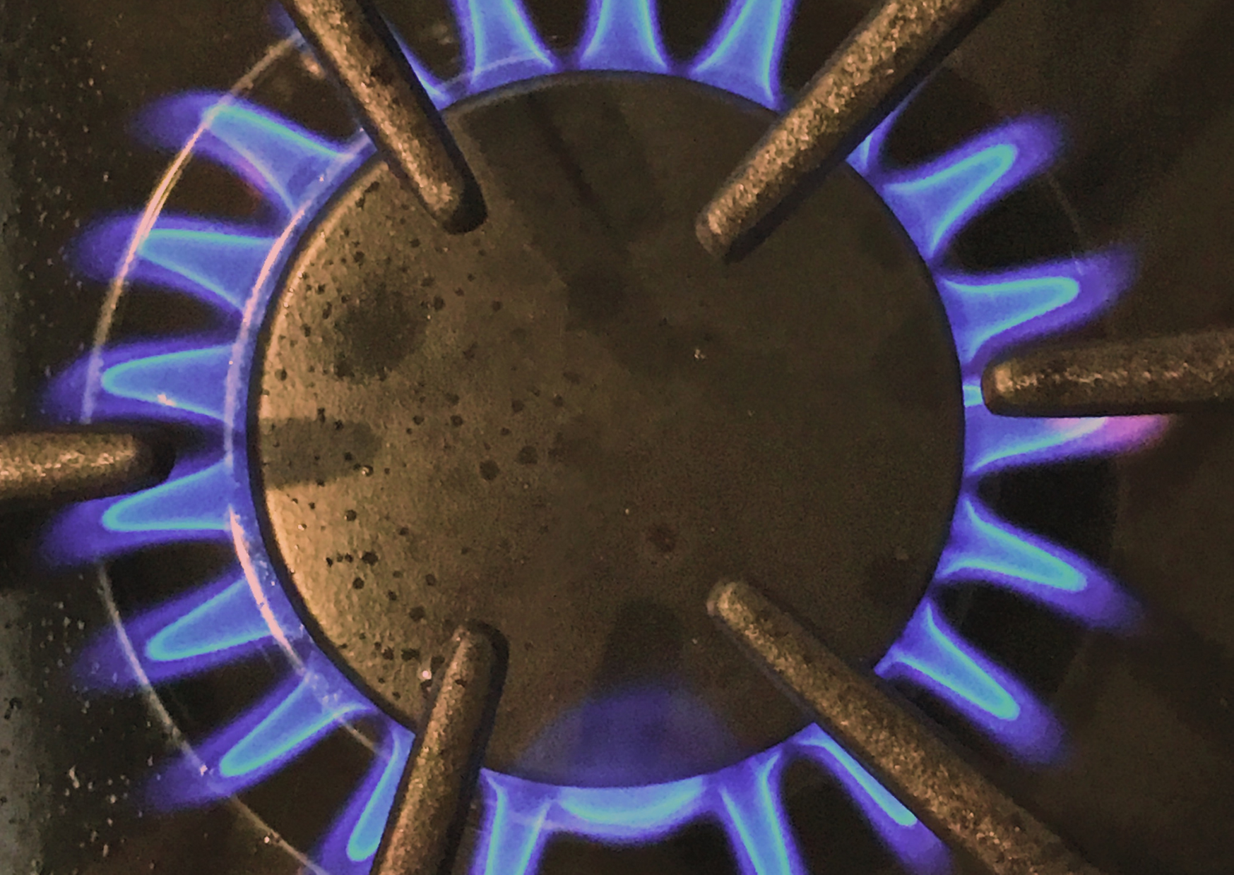 Photo of gas stove burner coming out fire