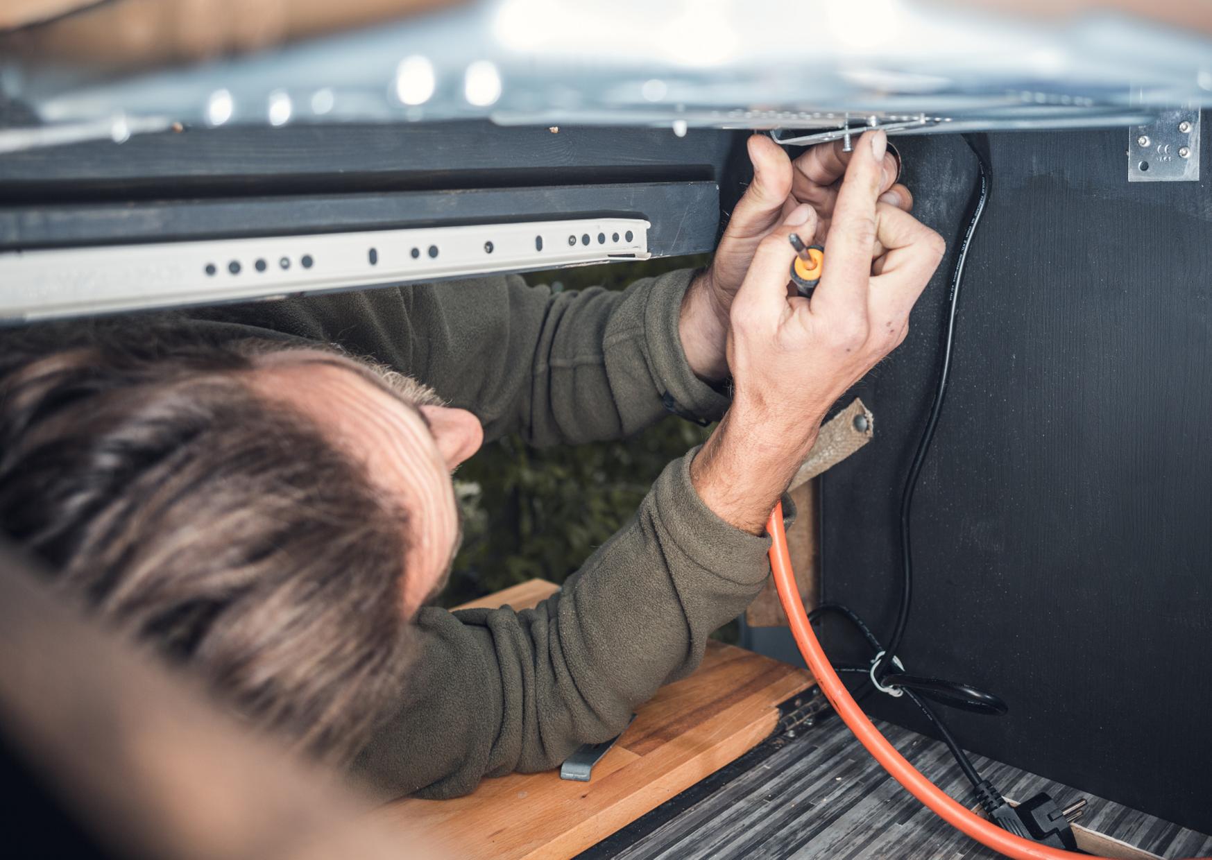 Man installing gas stove