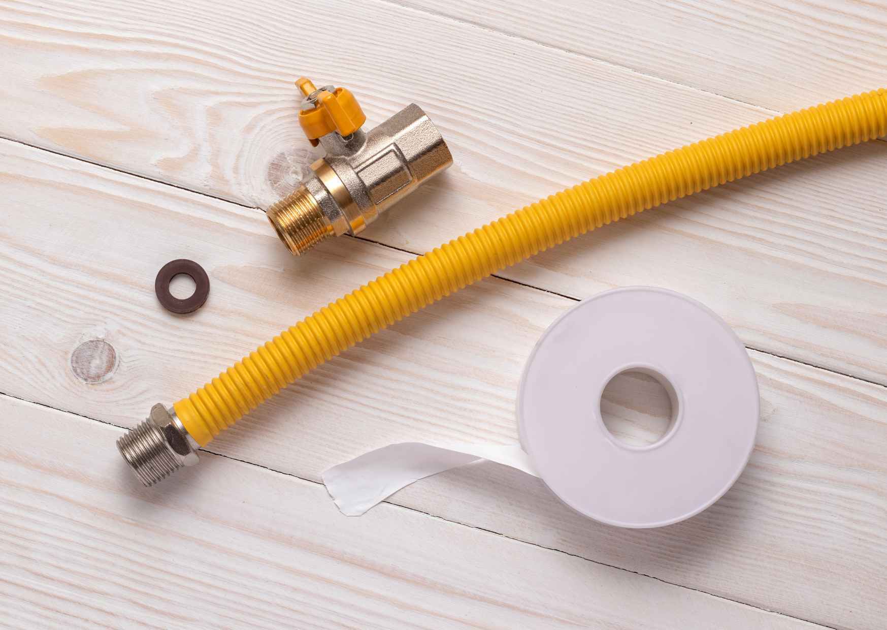 photo of a gas hose, tape and connector