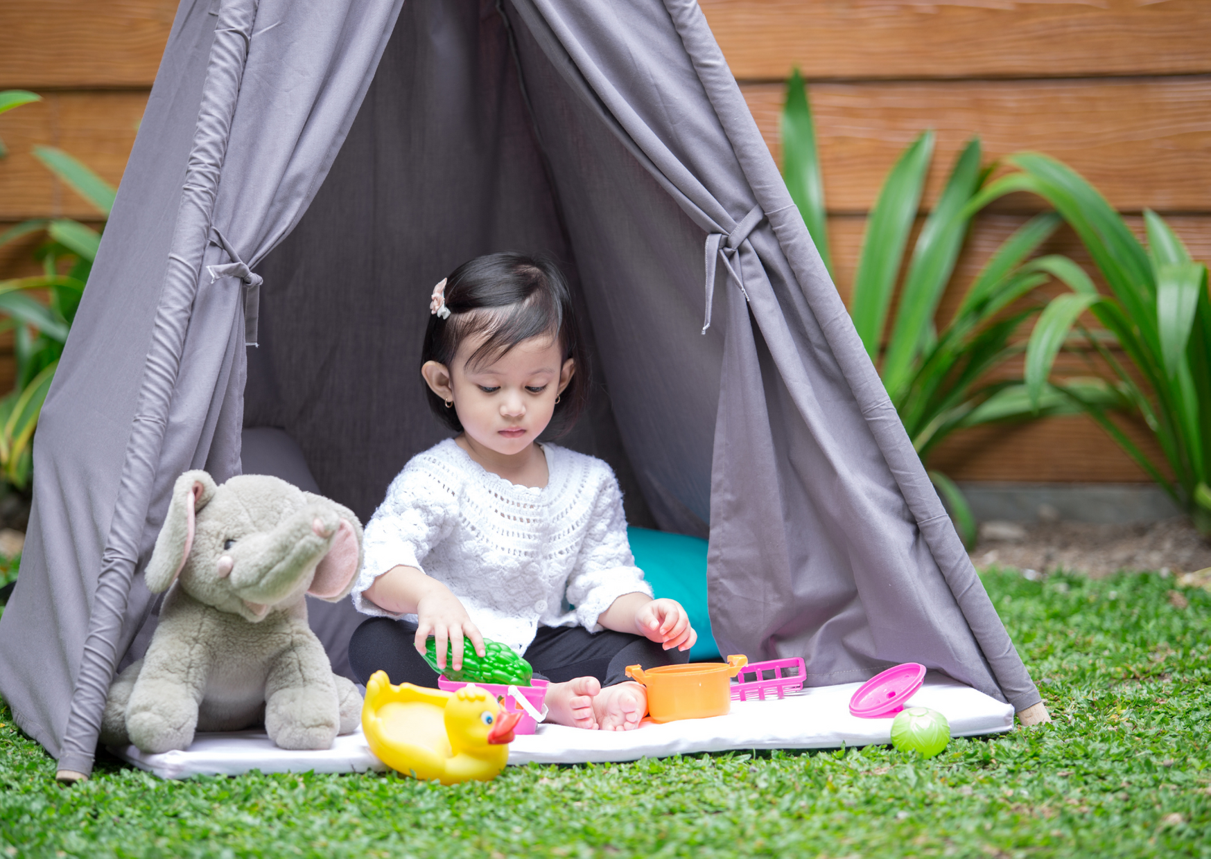 Kid playing inside the small tent of The Backyard Heroes Activity Tent and Alternative Play Tents for Kids Backyard Camping