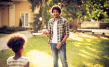 Man having fun with kids in backyard