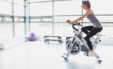 Women Exercise using bike