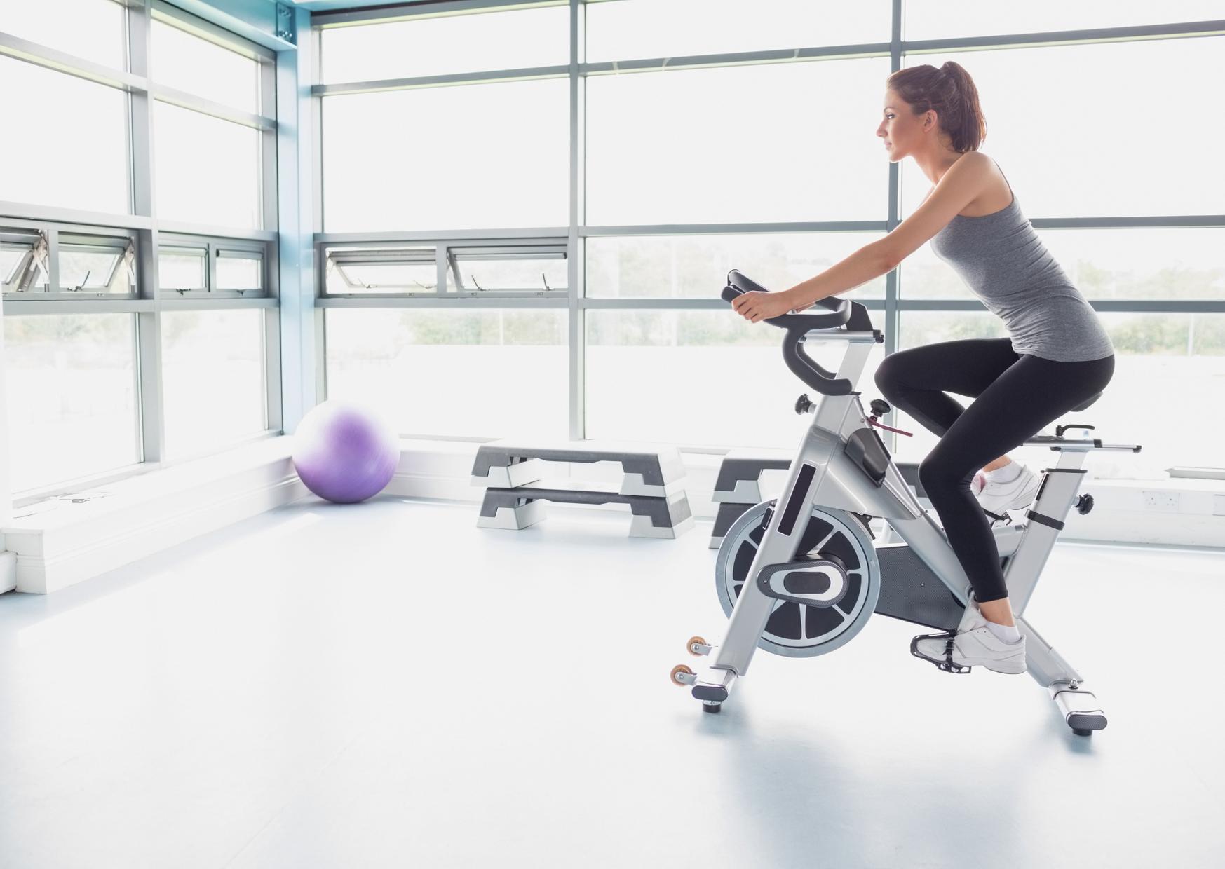 Women Exercise using bike