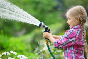 Kids using a garden hose