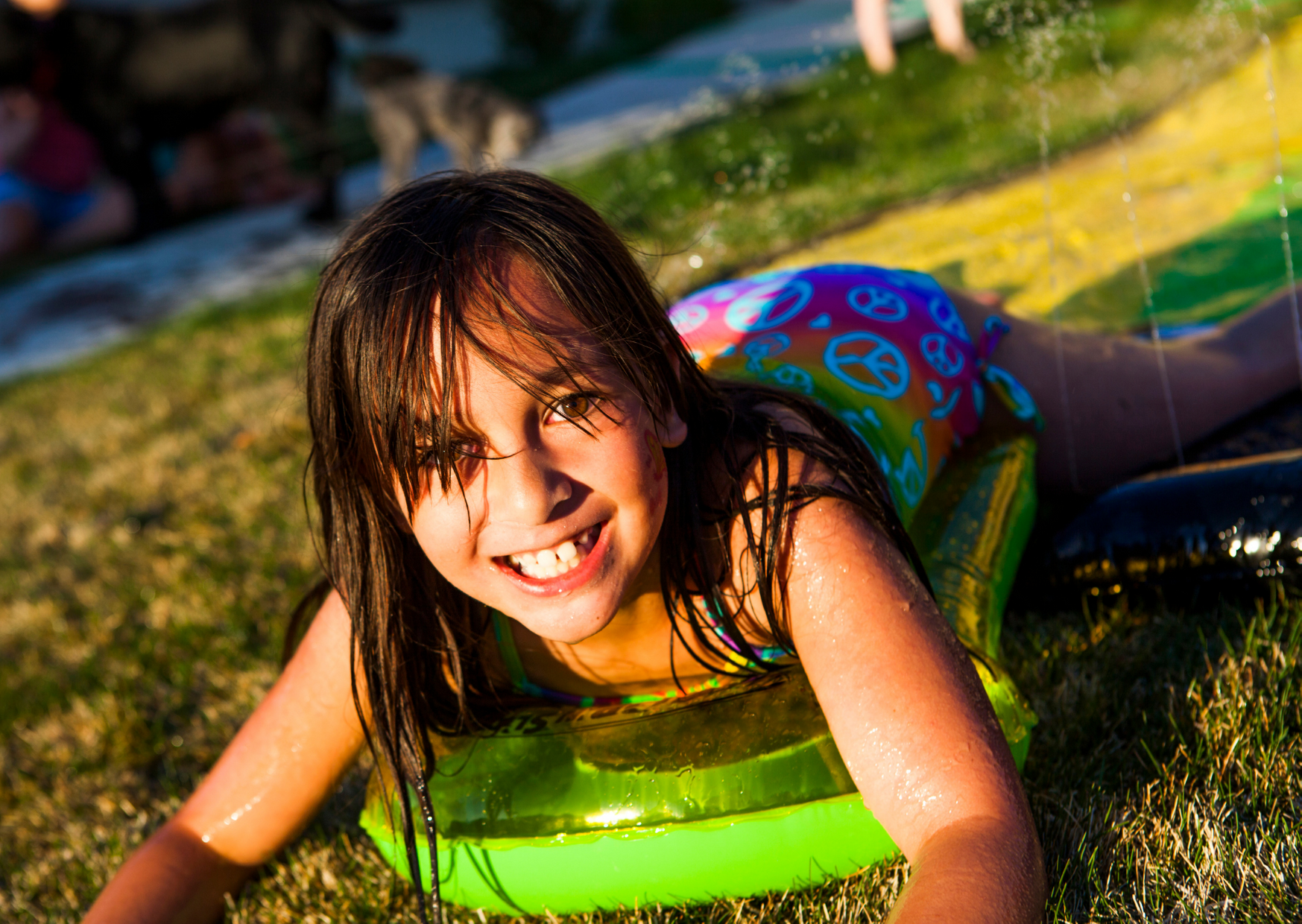 Kid having fun with the slip and slide