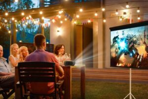 family watching outside using projector