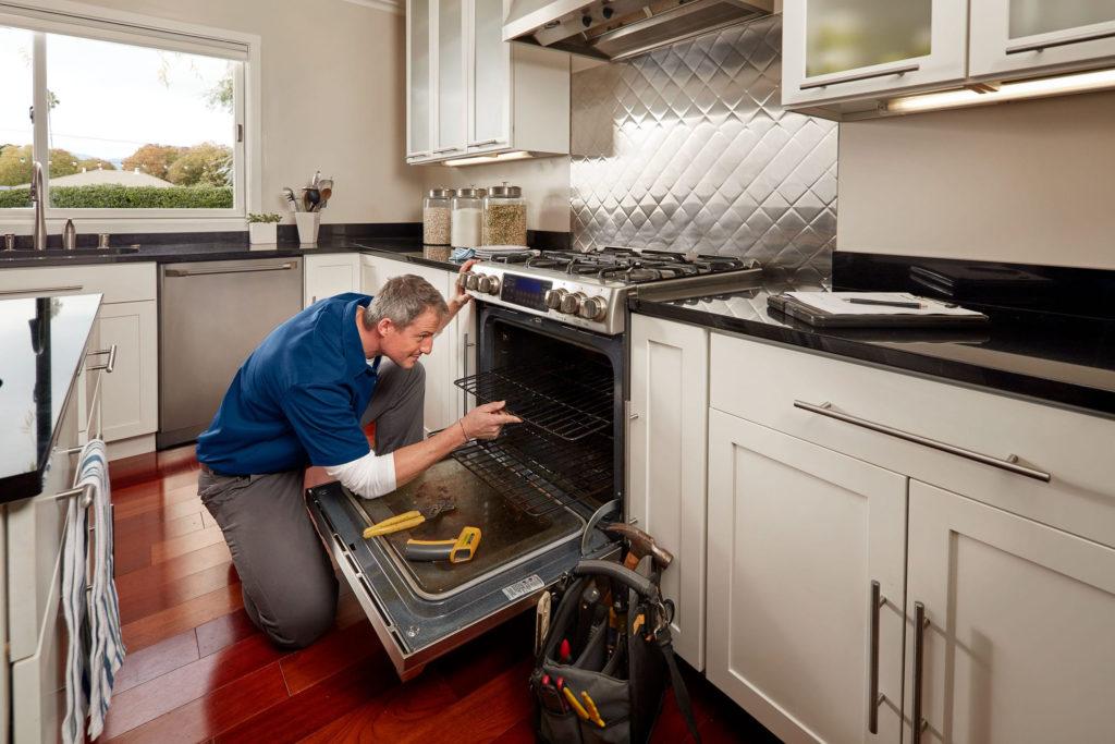 man repairing stove