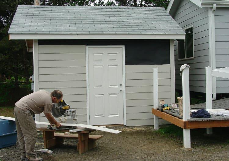 Man making backyard shed
