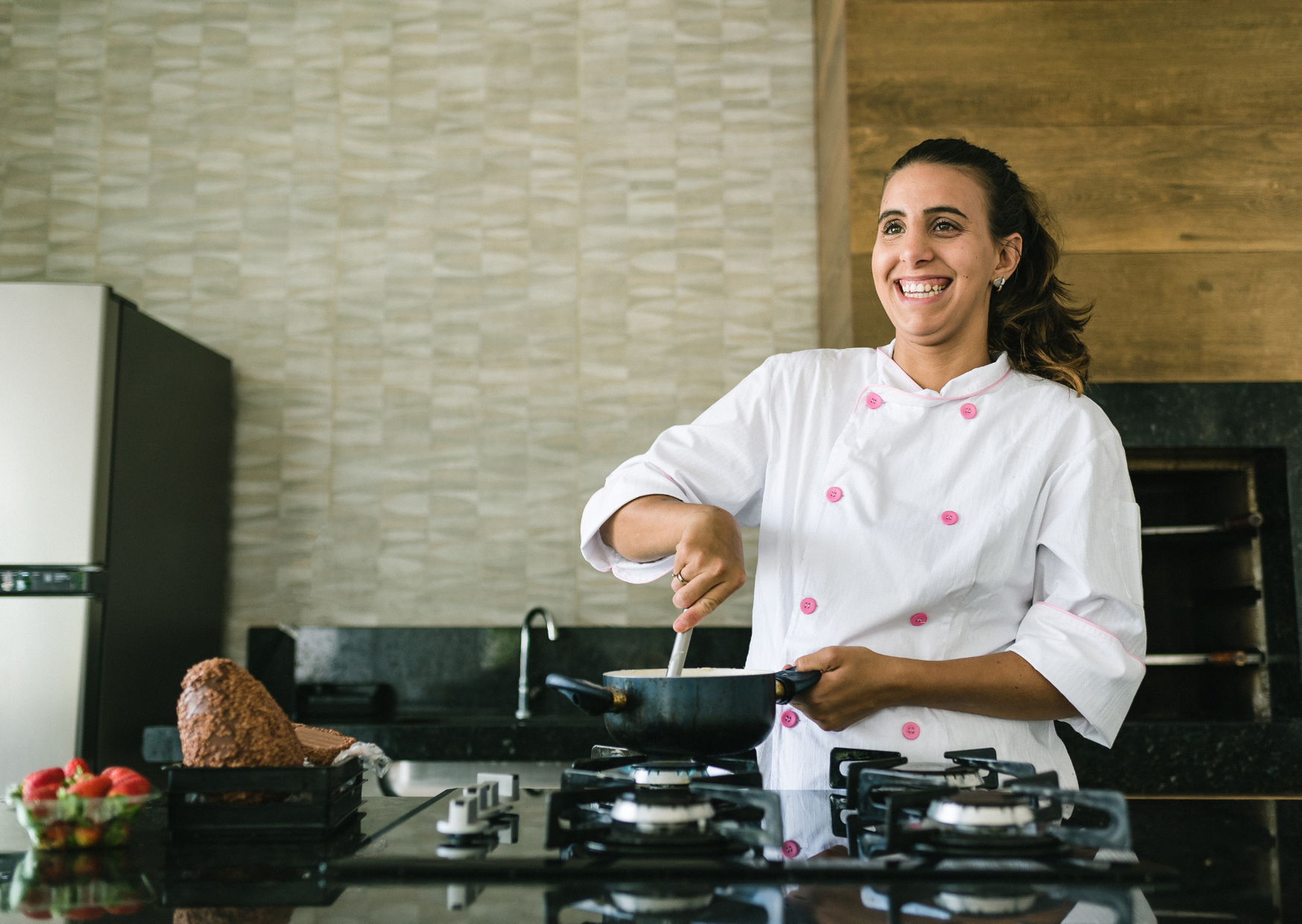 a chef smiling while cooking