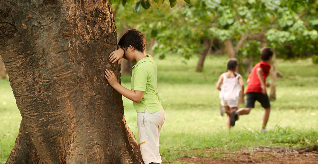 Kids playing hide and seek in Fun Things to Do In your Backyard When You Are Bored