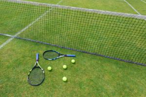a tennis rockets with balls