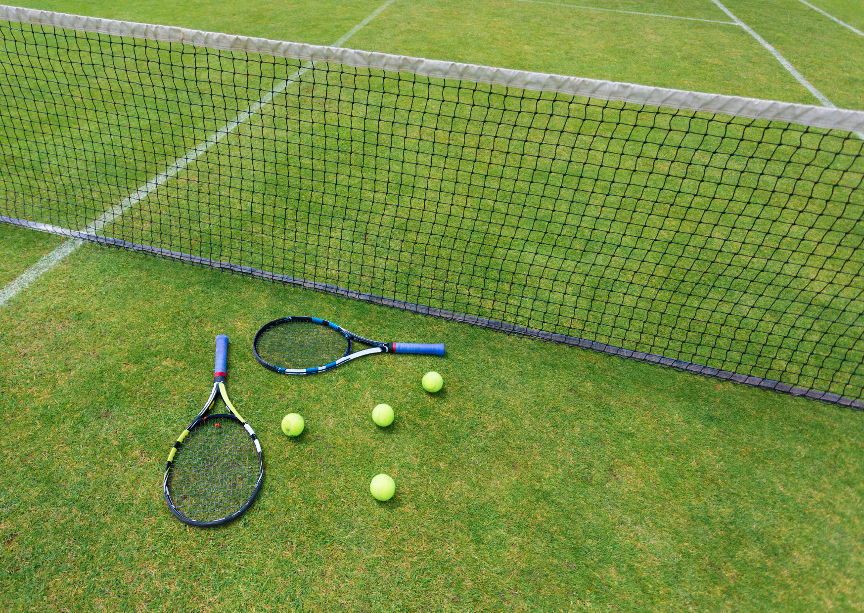 a tennis rackets with balls of Is Lawn Tennis an Indoor Game?