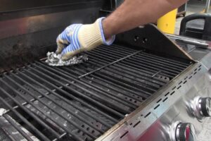 People cleaning grill