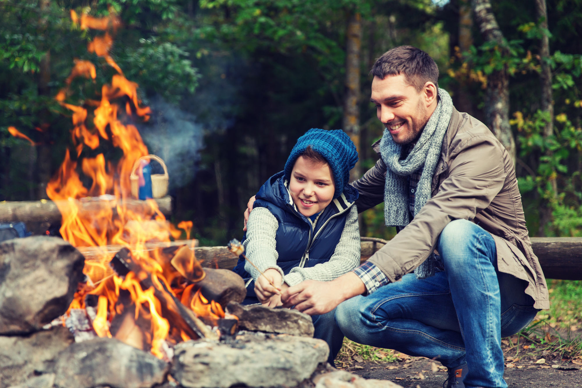 Father and son build a bonfire