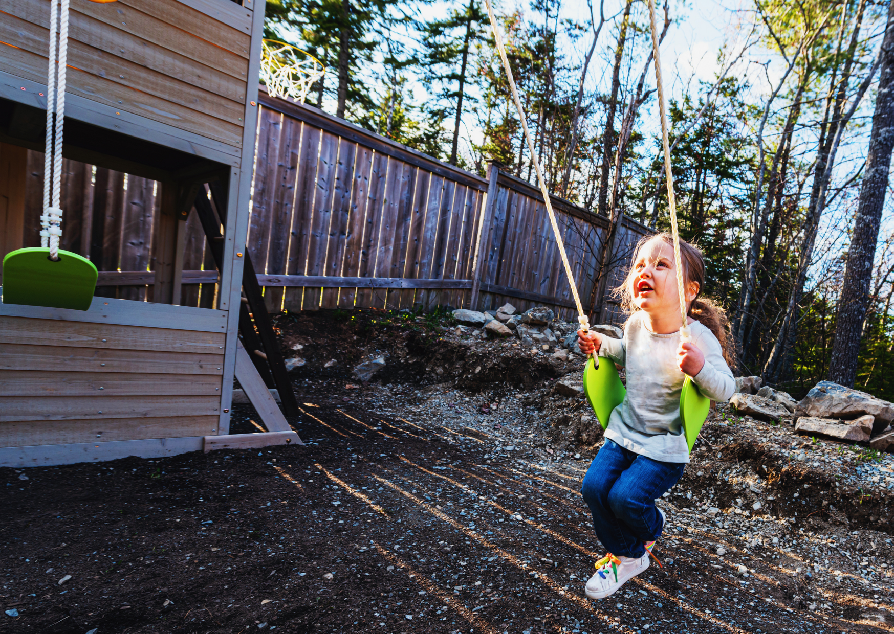 Kids playing in the backyard of The Family Fun Pack: Our Picks for the Top Backyard Playgrounds