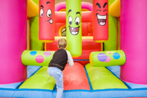 Kids playing jumping castle