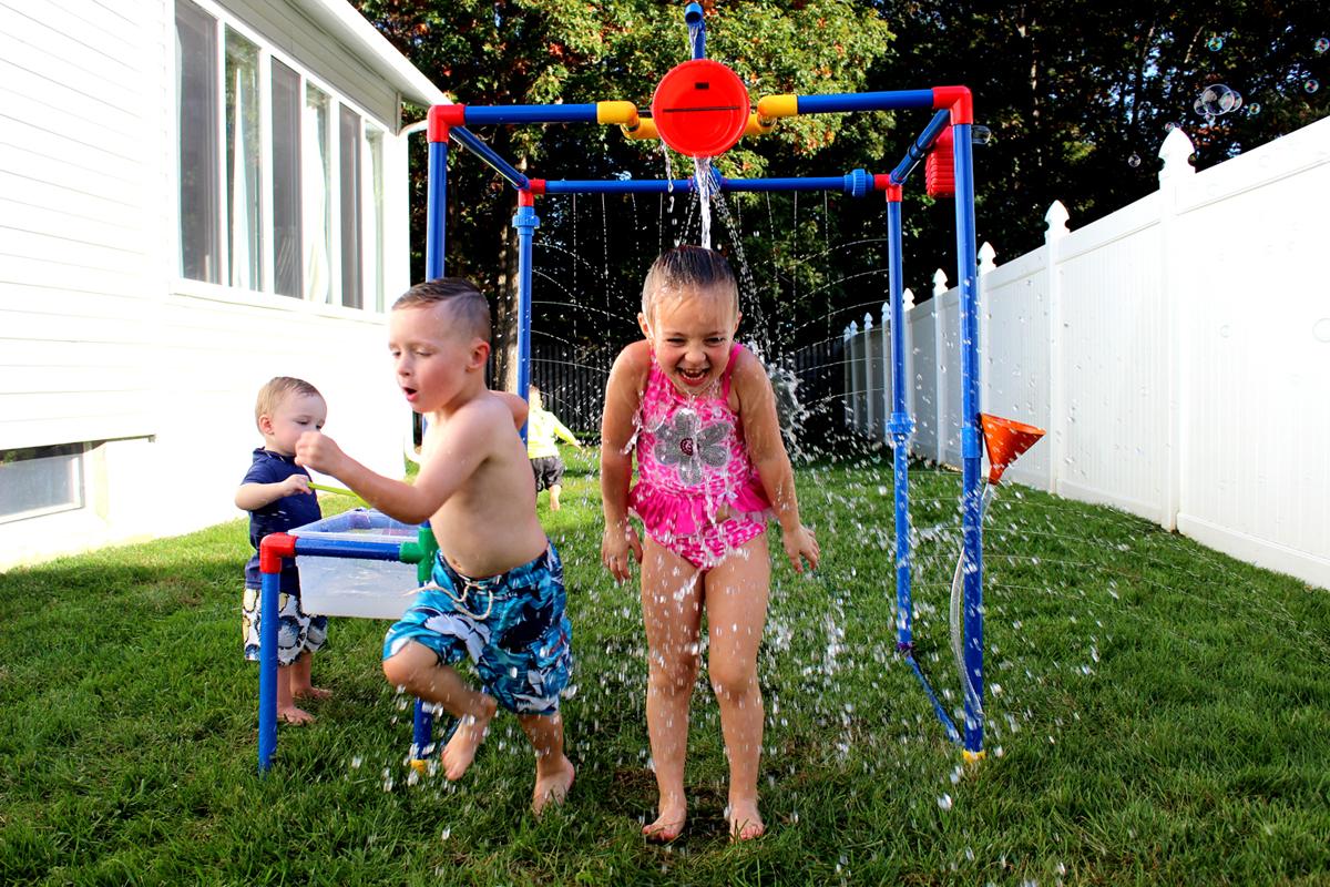 Kids Playing bucket of fun of Buckets of Fun 6-in1 Backyard Waterpark