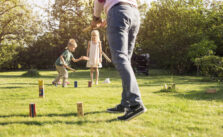 Playing wooden peg lawn game