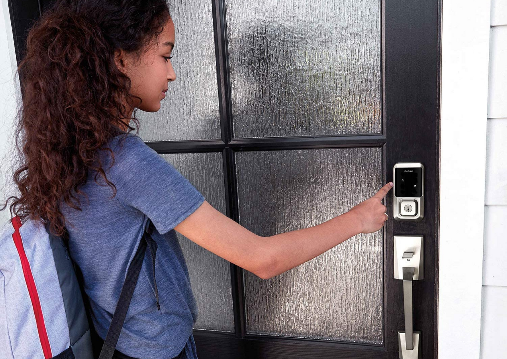 a girl opening the door of Best Rated Home Smart Locks