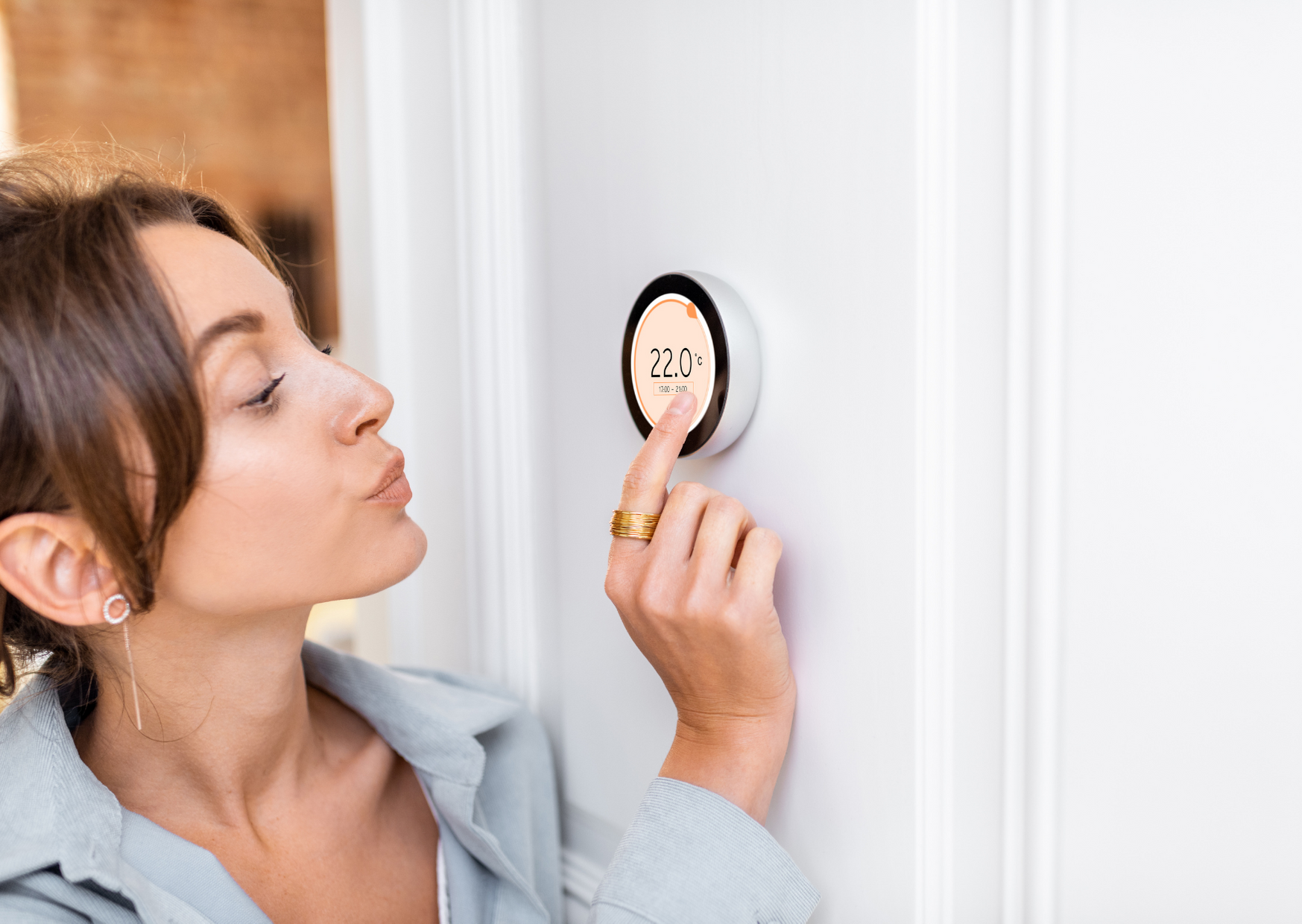 Women setting up the smart thermostats