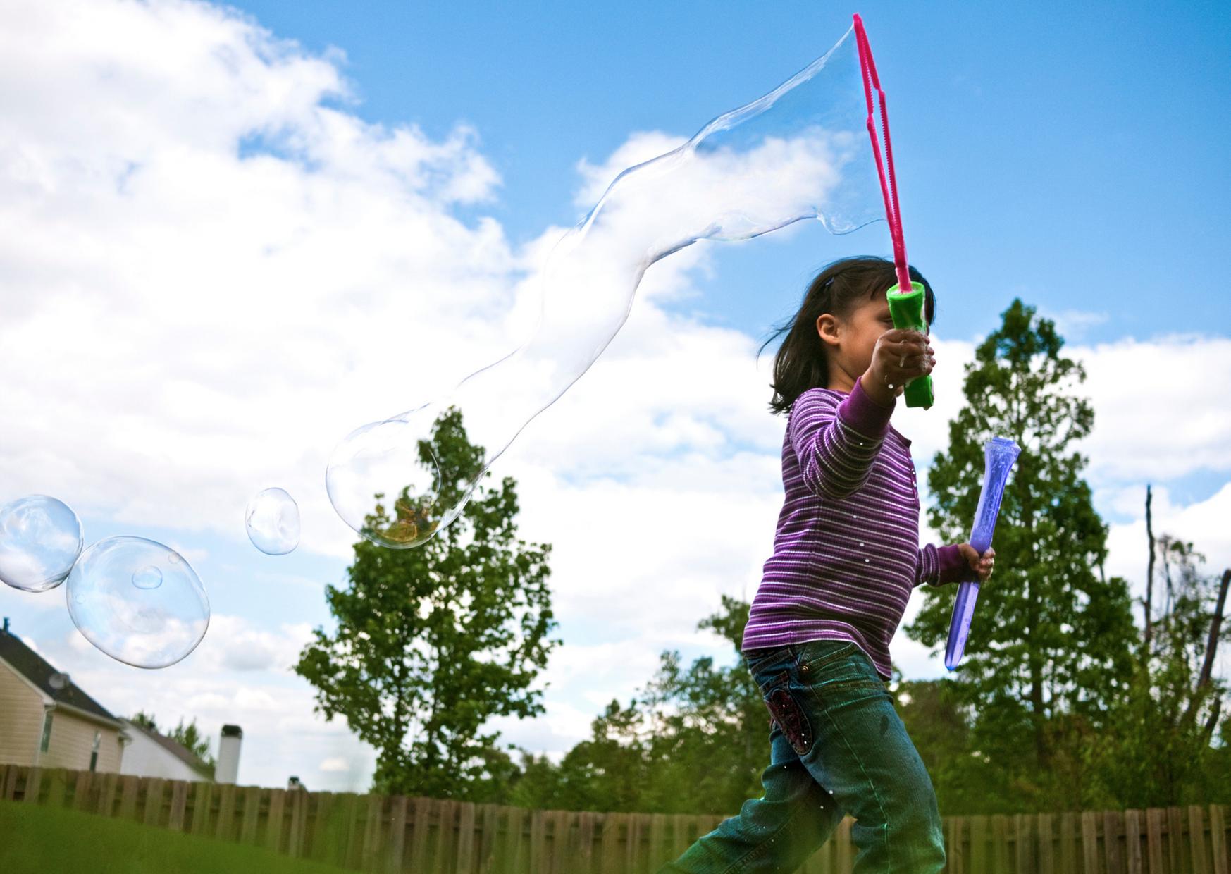Photo of kid playing backyard fun pack
