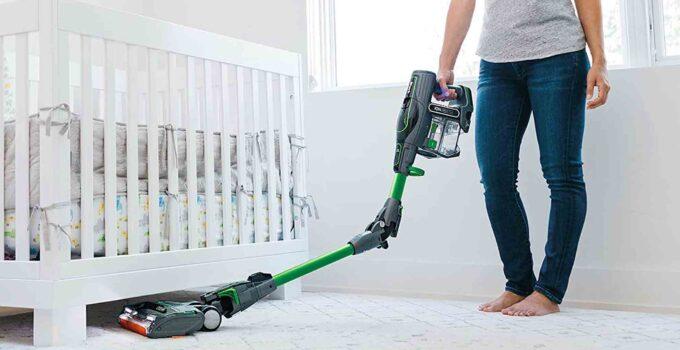 Photo of women using stick vacuum